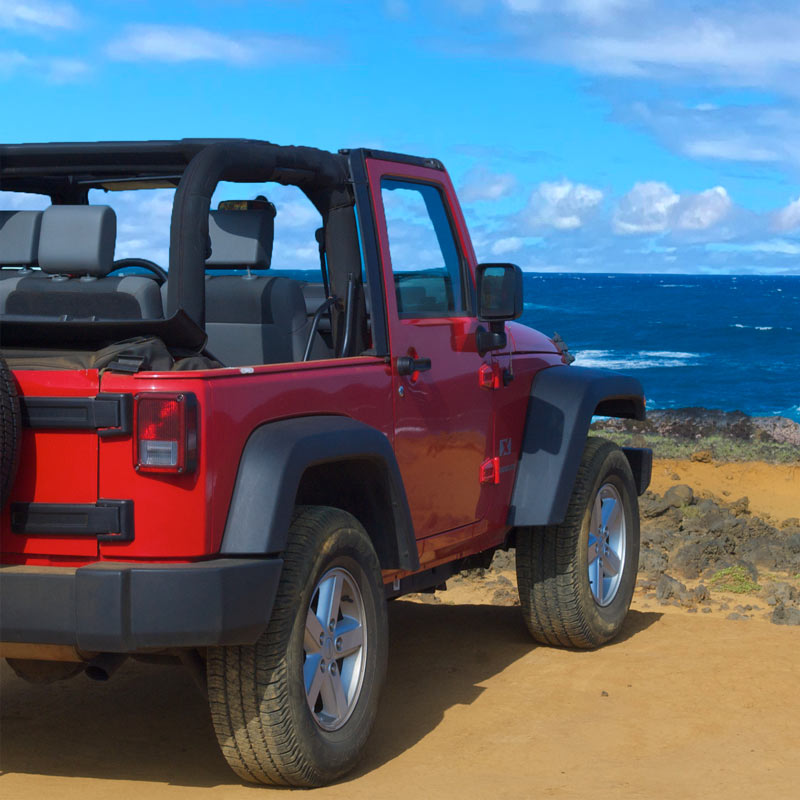 The owners Jeep on a beach on Hawaii Island